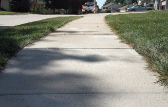 Sunken sidewalk raised with our concrete leveling solution